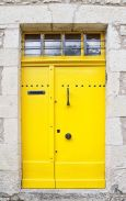 yellow door with window
